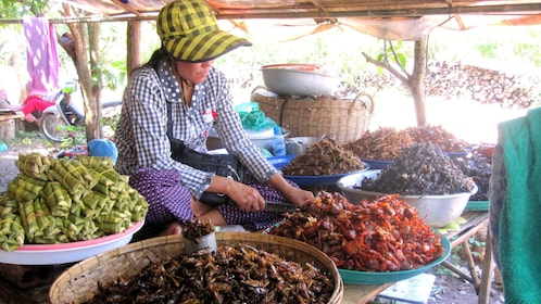 Woman selling goods at a market in Siem Reap