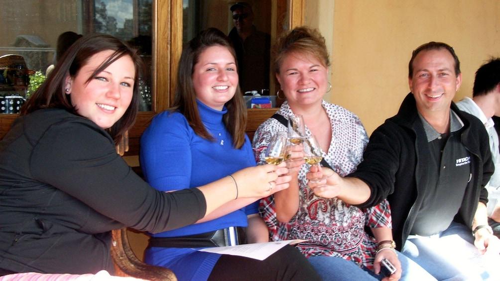 Show item 5 of 8. Family enjoying wine tasting in the Hunter Valley region of Australia