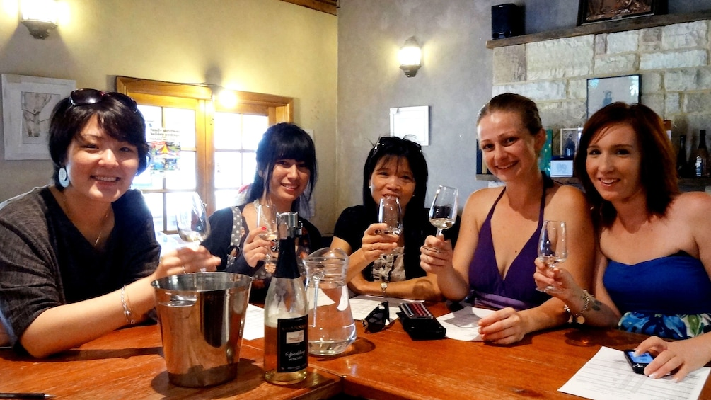Show item 1 of 8. Group enjoying wine in the Hunter Valley region of Australia