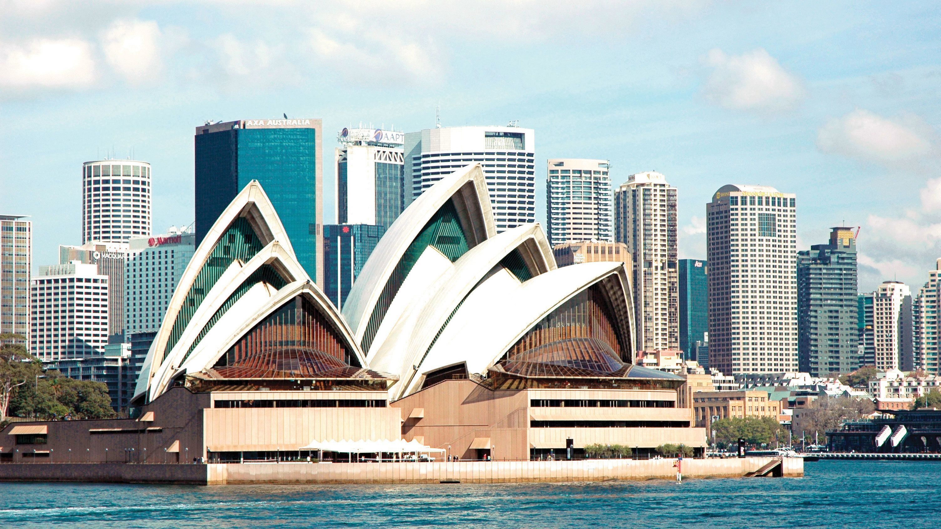 Close view of the Sydney Opera House and city buildings from the Sydney Harbour
