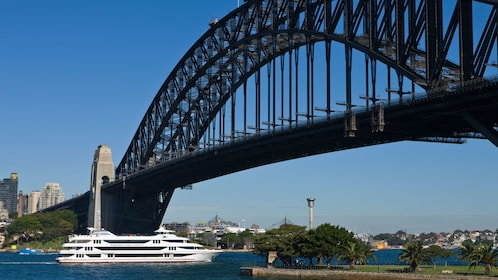 Scenic view of the Harbour Bridge and cruise ship on the waters of the Sydney Harbour during a clear blue sky day