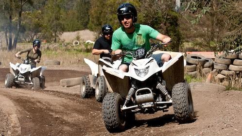 Guests riding quad-bike ATVs at Glenworth Valley