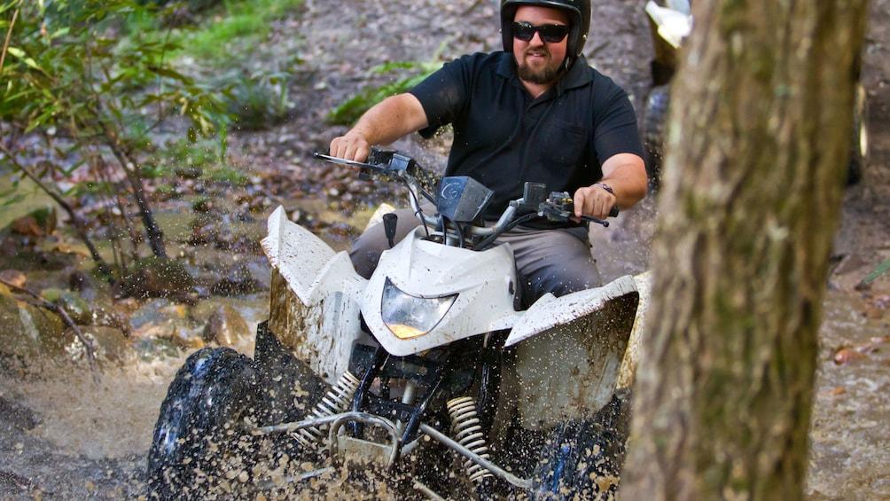 Show item 5 of 5. Man driving quad-bike ATVs at Glenworth Valley