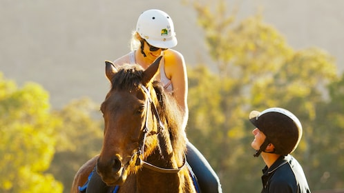 Woman riding a horse at Glenworth Valley in Australia
