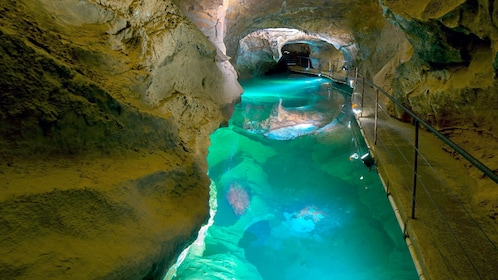 View inside the Jenolan Caves with blue waters inside the cave