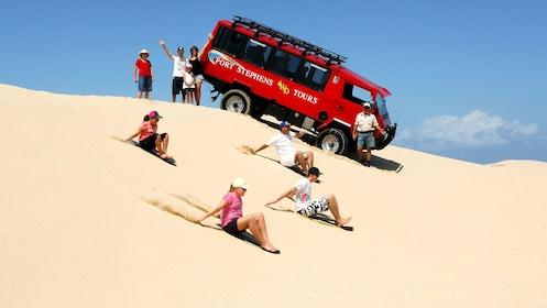 Guests sandboarding at Stockton Beach in Australia