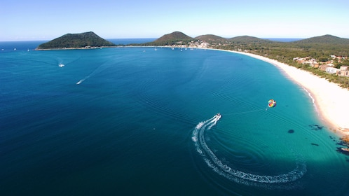 A luxury boat cruising in the waters of Port Stephens in the North Coast region of Australia
