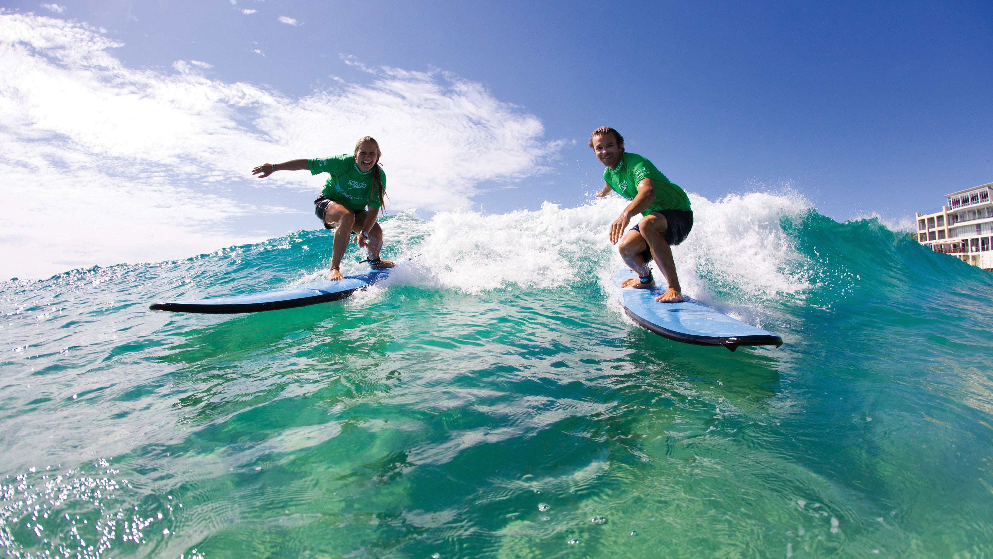 Two surfers making waves on Bondi Beach on a wonderful clear day