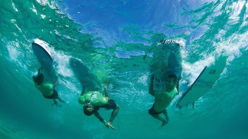 Underwater view of some surfers in Bondi Beach