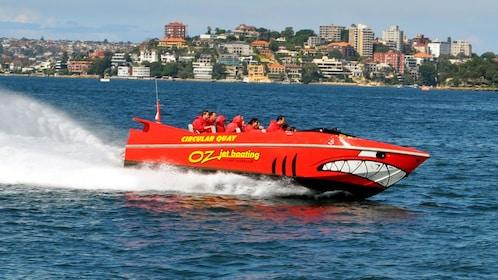Jet boat flying across water's surface in Sydney Harbor
