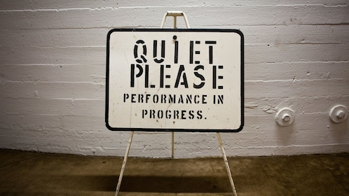 Sign that reads quiet please performance in progress backstage at the Sydney Opera House in Australia