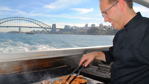 Chef grills up food on cruise in Sydney