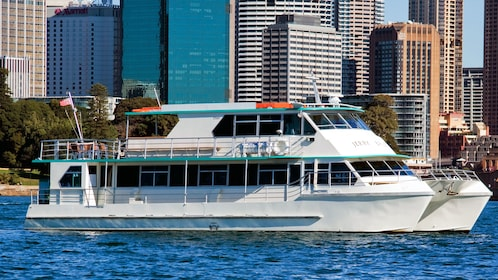 Beautiful look of a cruise boat in front of city towers of Australia