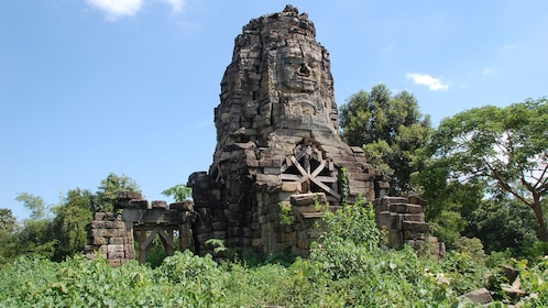 The ruins of a temple surrounded by jungle in Cambodia