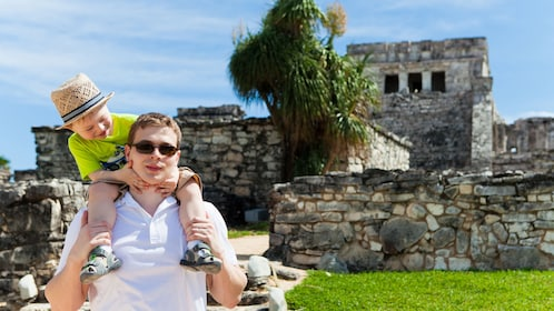 Father and son infront of the ruins of Tulum
