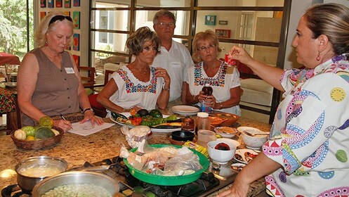 Teacher instructing the cooking class