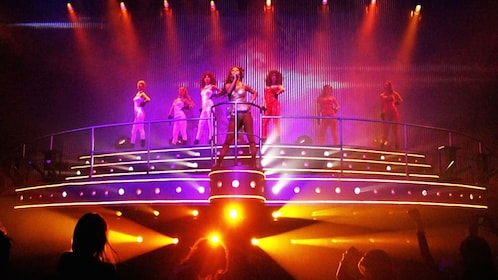Women singing and performing on stage at Coco Bongo in Cancun