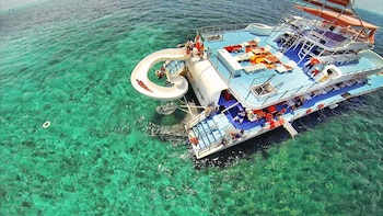 Party Boat with Snorkelling & Isla Mujeres Visit