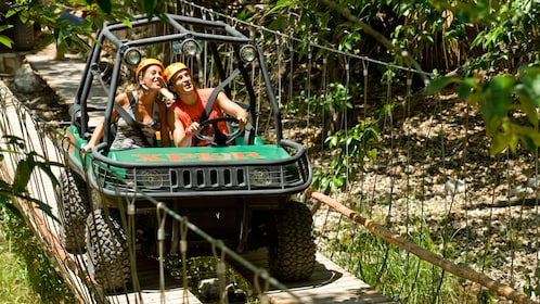 Couple on a 4 wheel drive adventure at Xplor park in Cancun