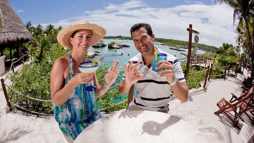 Couple with tropical drinks in Cancun