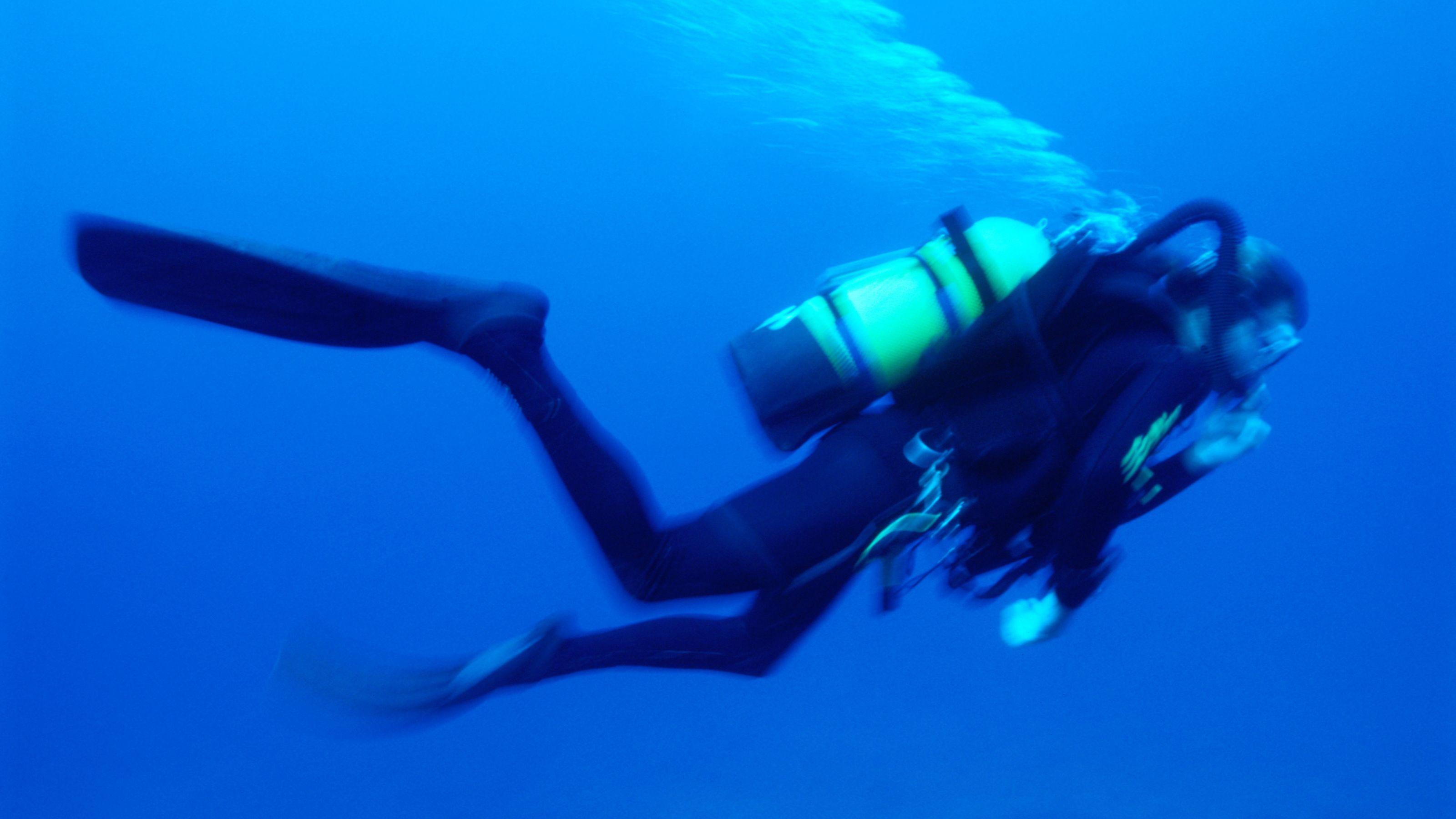 Scuba diver swimming in Cancun
