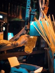 Bartender filling Beers at the tap