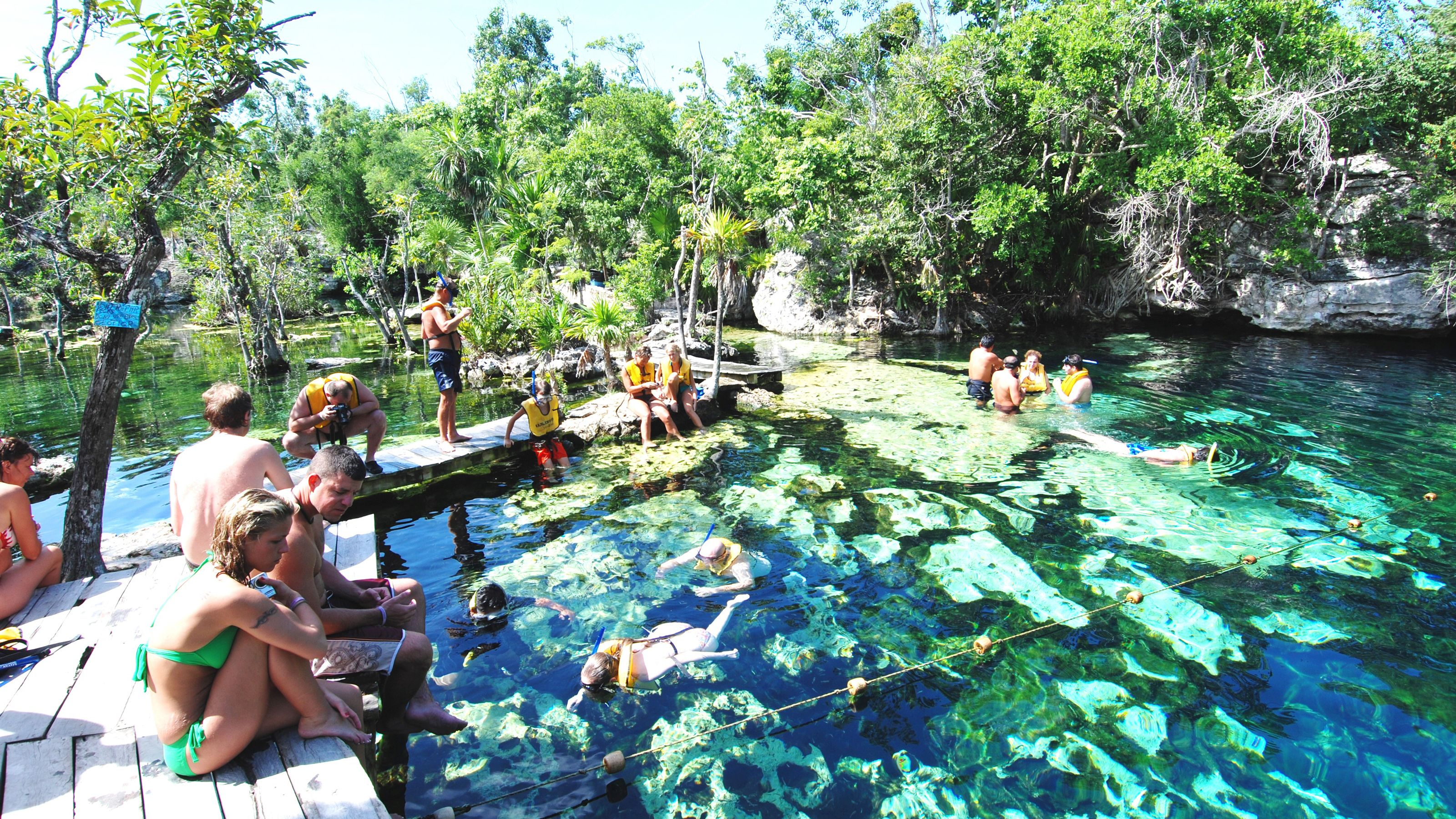 People swimming and snorkeling in a lagoon in Cancun