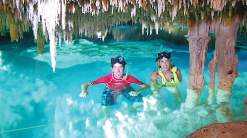 Snorkelers in an cavernous pool in Cancun