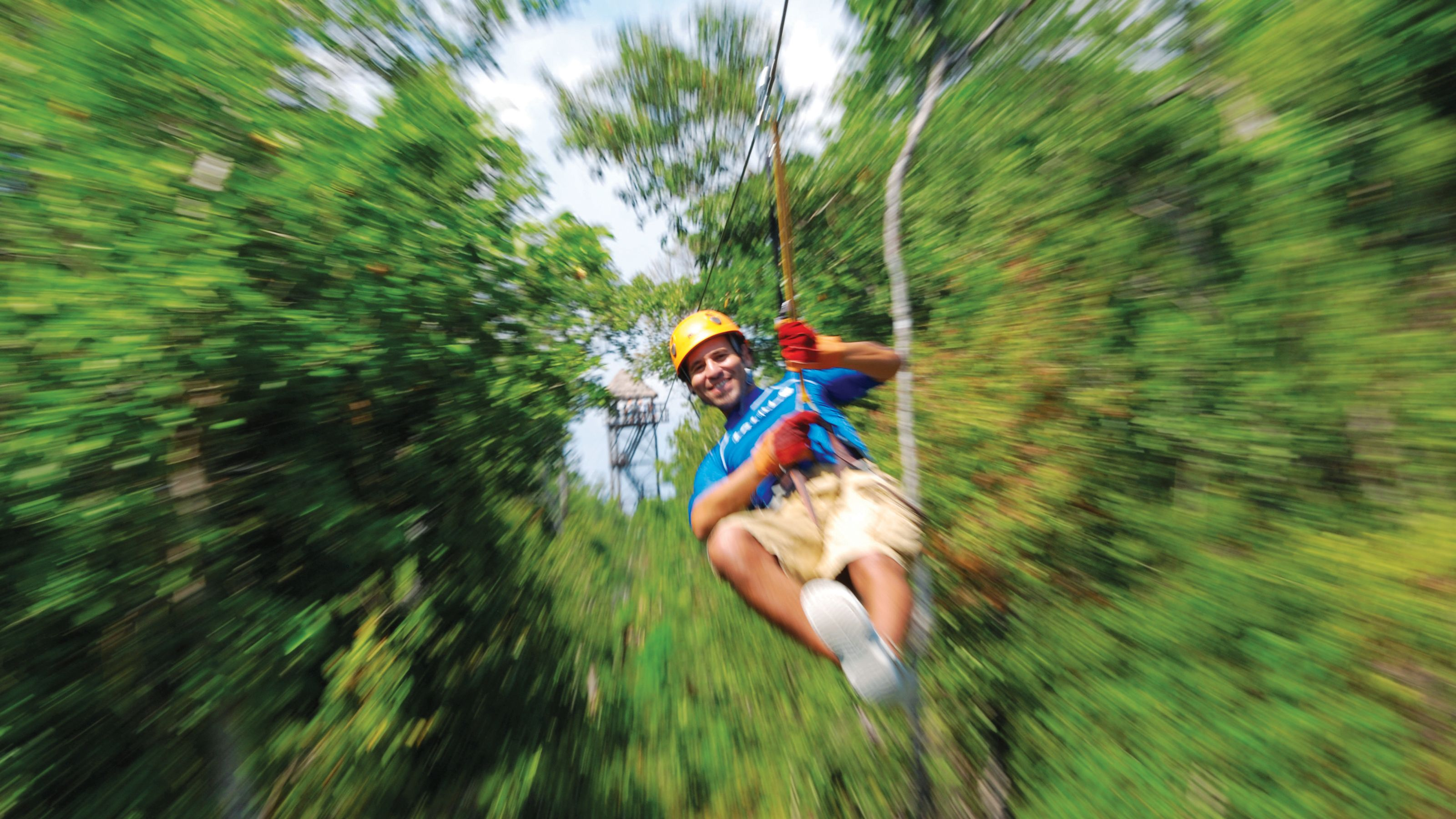 Ziplining through the trees in Cauncun