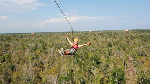 Zipliner over the jungle canopy in Cancun