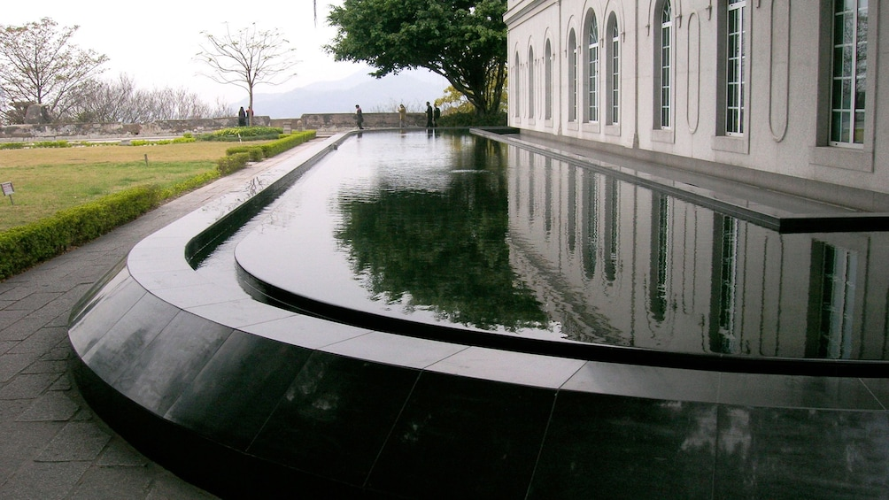 Show item 2 of 8. Reflecting pool outside of building in Macau
