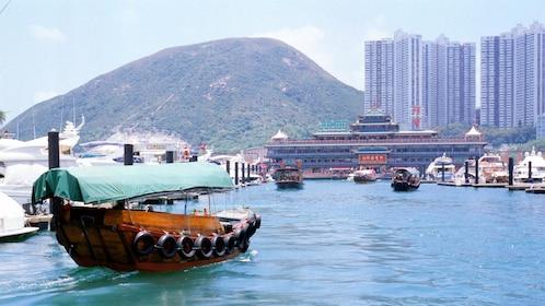Boat traveling through marina in Hong Kong