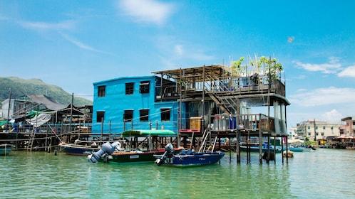 Buildings on stilts over water of Lantau Island in Hong Kong
