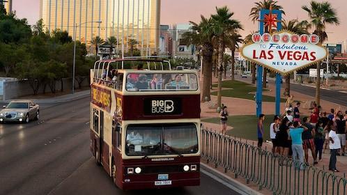 Las Vegas signature sign is a featured landmark on the double decker bus tour