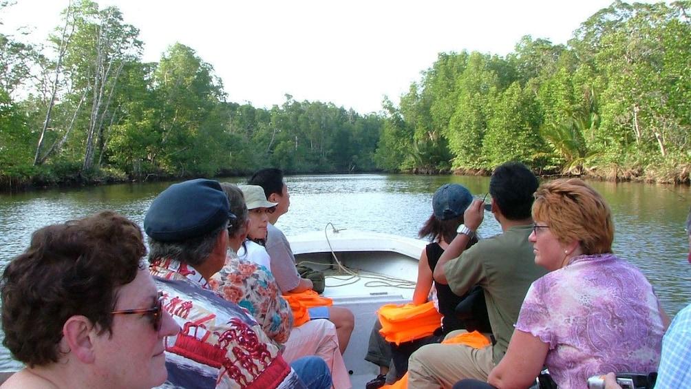 Show item 3 of 5. People on boat in Kota Kinabalu