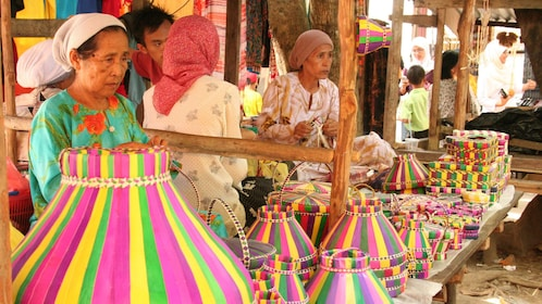 women selling brightly colored baskets in Kota Kinabalu