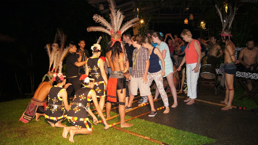 Show item 4 of 5. people dancing in kota kinabalu