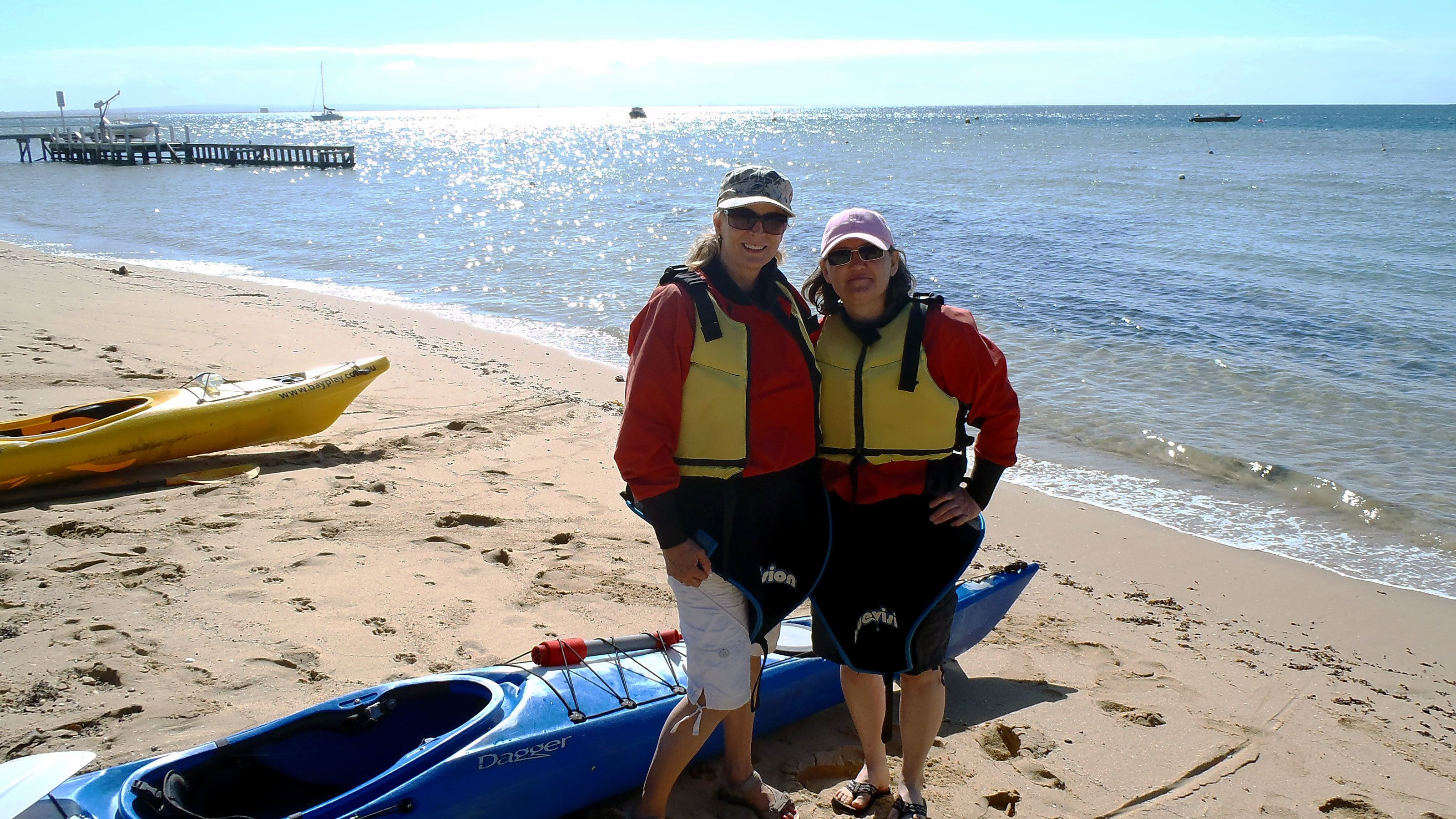 Two women with their Kayak on a beach at Mornington Peninsula
