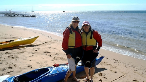 Two women with their Kayak on a beach at Mornington Peninsula