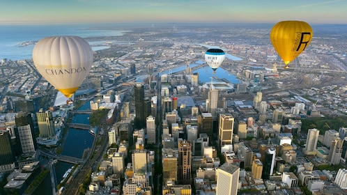 Hot air balloons flying over the city of Melbourne