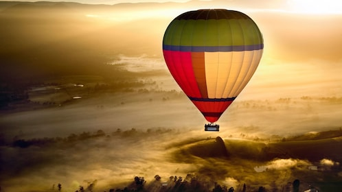 Sunrise as seen from a hot air balloon high over Yarra Valley