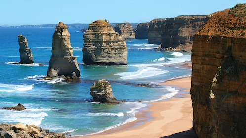 The Twelve Apostles rock stacks emerge from the water along the coast at Port Campbell National Park in Melbourne