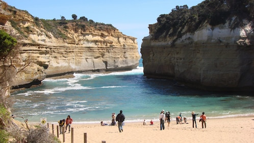 Tour group on sandy beach in Port Campbell National Park in Melbourne