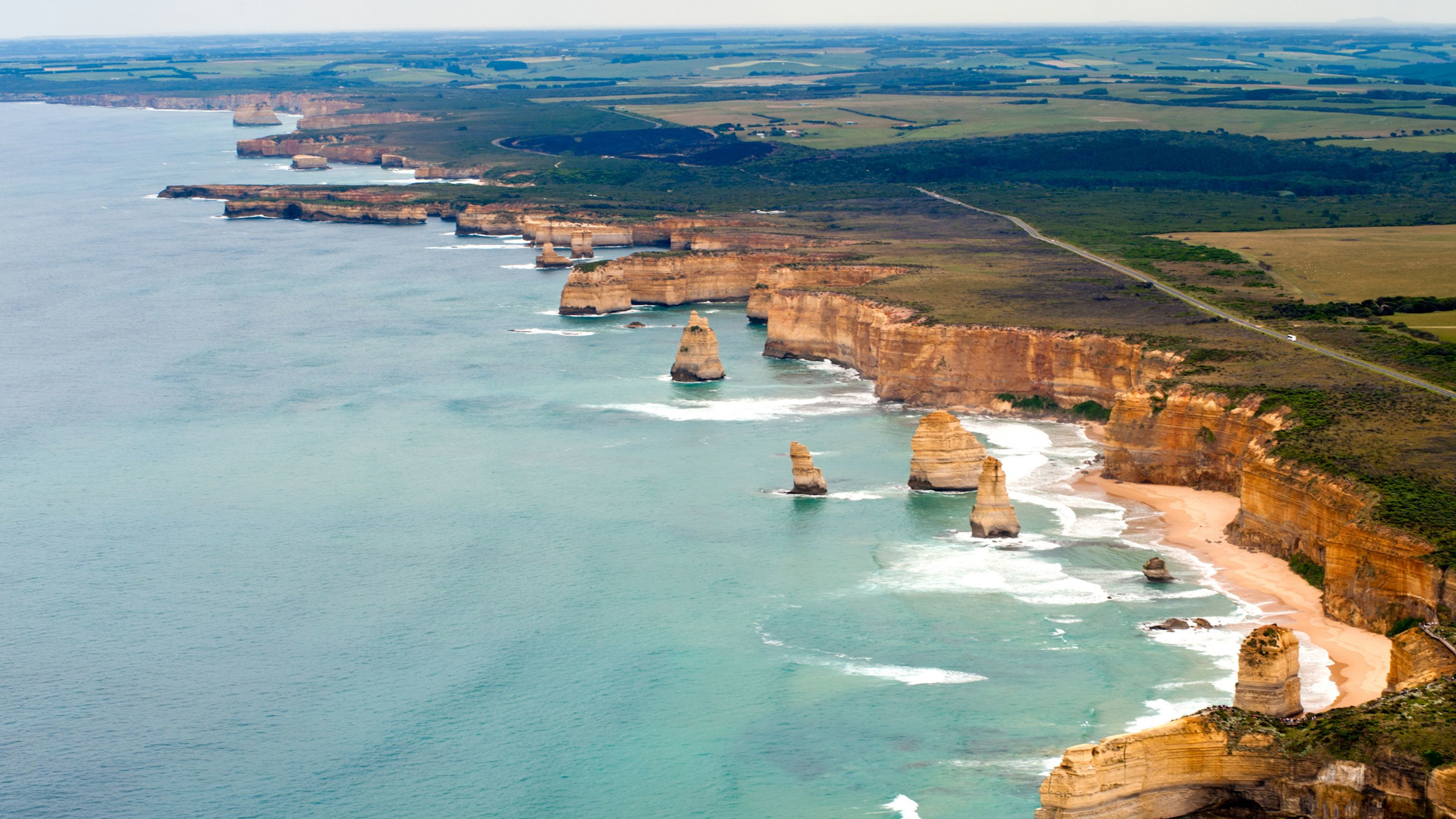Aerial view of the coast cliffs and the Twelve Apostles rock stacks along the Great Ocean Road in Melbourne