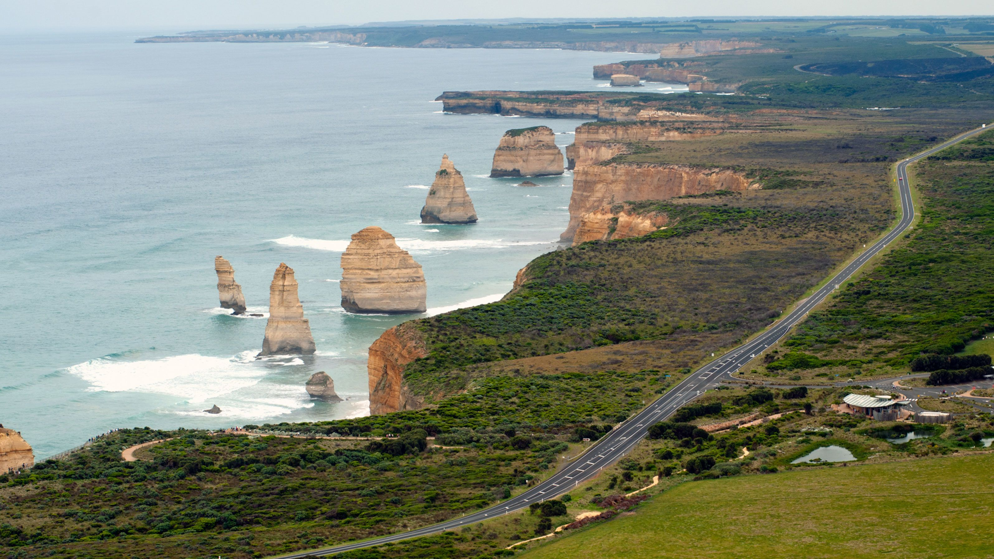 The Great Ocean Road near coastal cliffs and the towering Twelve Apostles rock stacks in Melbourne