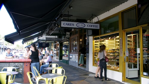 Sidewalk with shops, cafes and outdoor seating in Melbourne