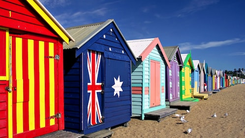 Iconic colorfully painted bathing boxes along the beach in Brighton