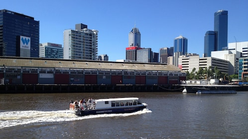Yarra River cruise boat with passengers in Melbourne