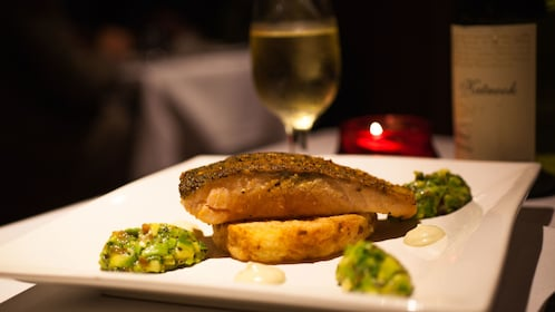 Salmon entree and white wine on a cruise ship in Melbourne