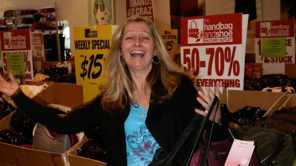 Show item 2 of 6. Smiling woman excited about sales at a store in Melbourne